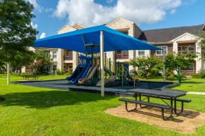 Apartments in Katy, TX - Covered Childrens Playground Area with Picnic Table